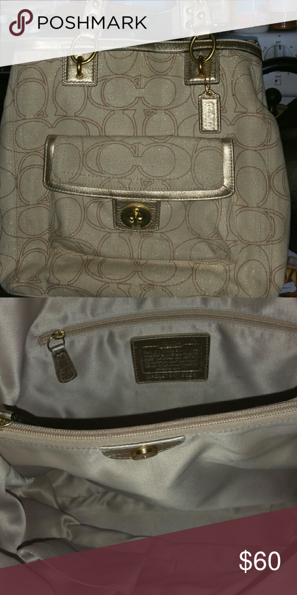 Coach Purse Beautiful coach purse with gold handles.  Only used a few times very clean inside abd out. Coach Bags Totes