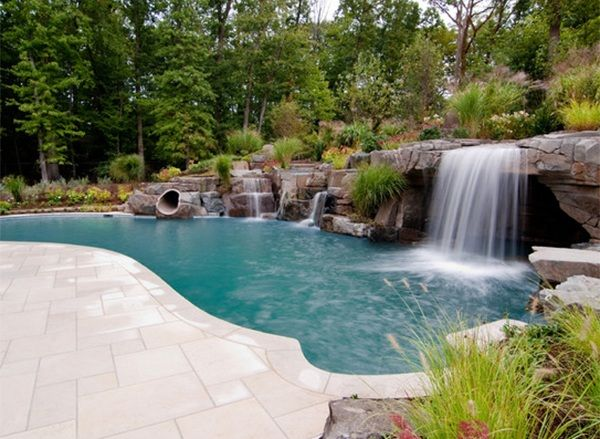 This Residence Has A Lovely Pool Area With Well Designed Landscape And Waterfalls Pool Waterfall Pool Landscaping Swimming Pool Waterfall