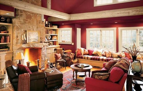 The living room designed in red and brown looks amazing and very