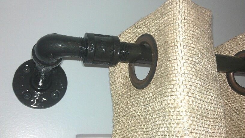 Our new black iron pipe curtain rod with burlap curtains! #DIY