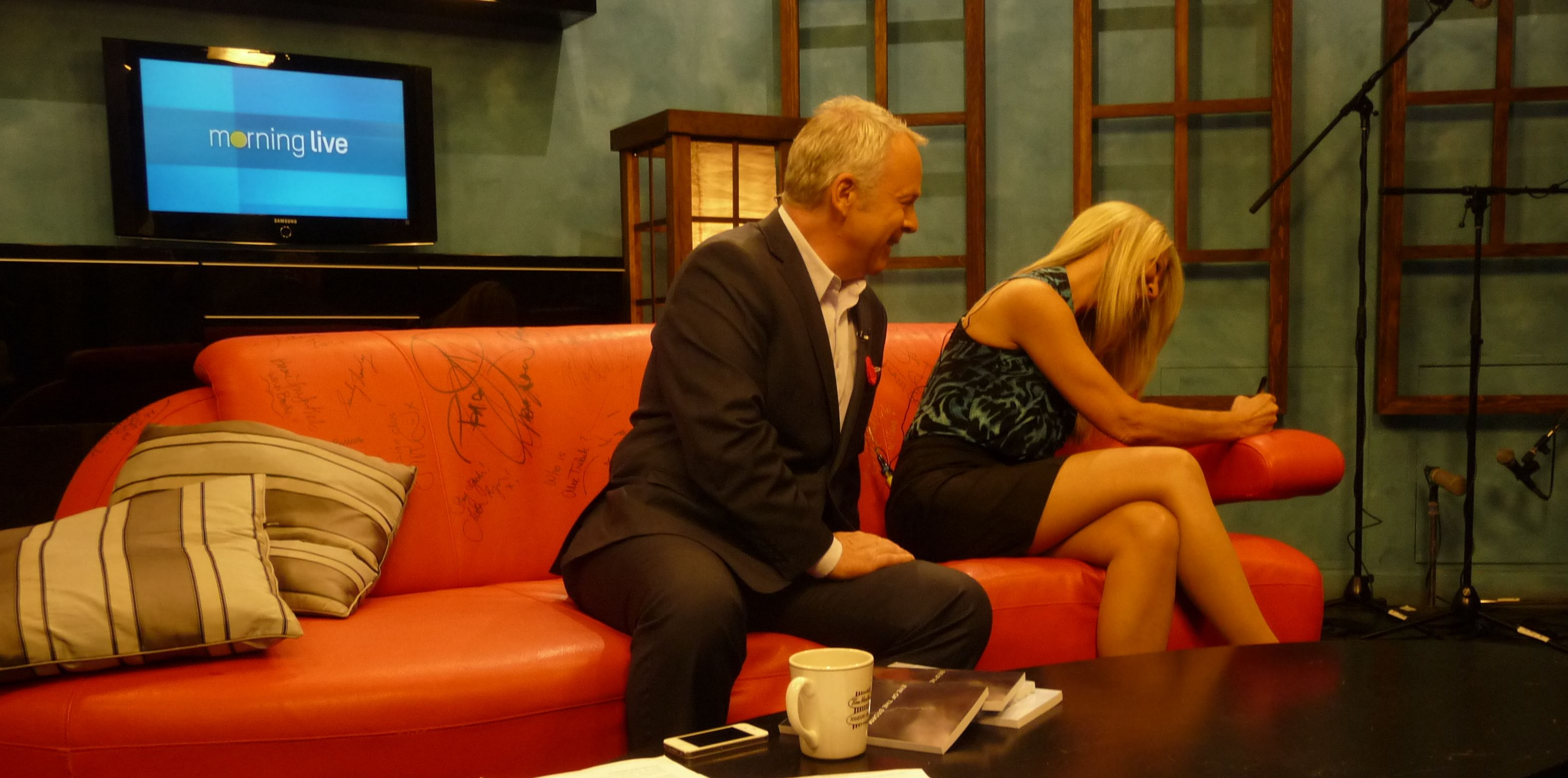 Signing the Celebrity Couch during a morning news show