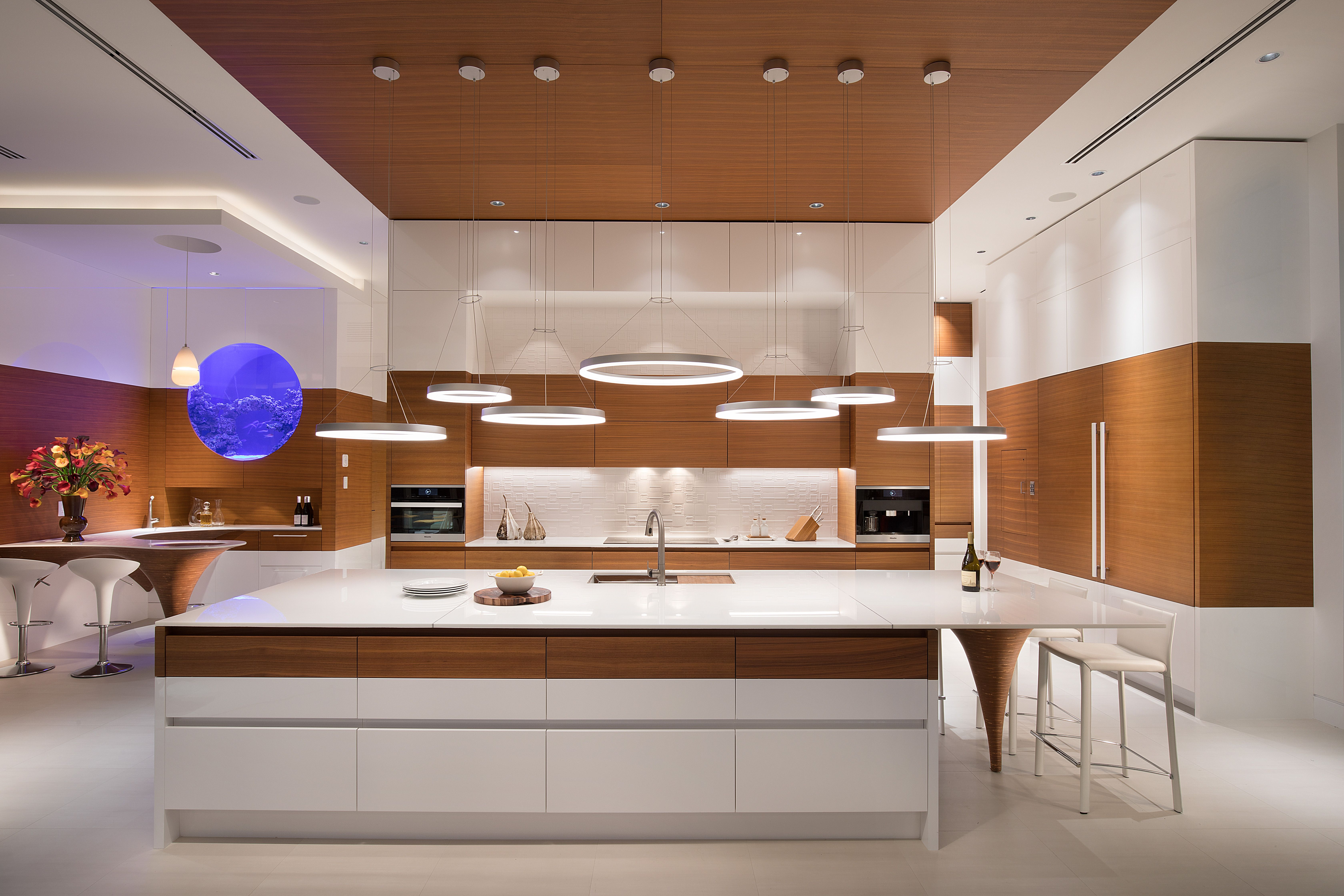 Modern kitchen with a futuristic design for a home in florida this two tone