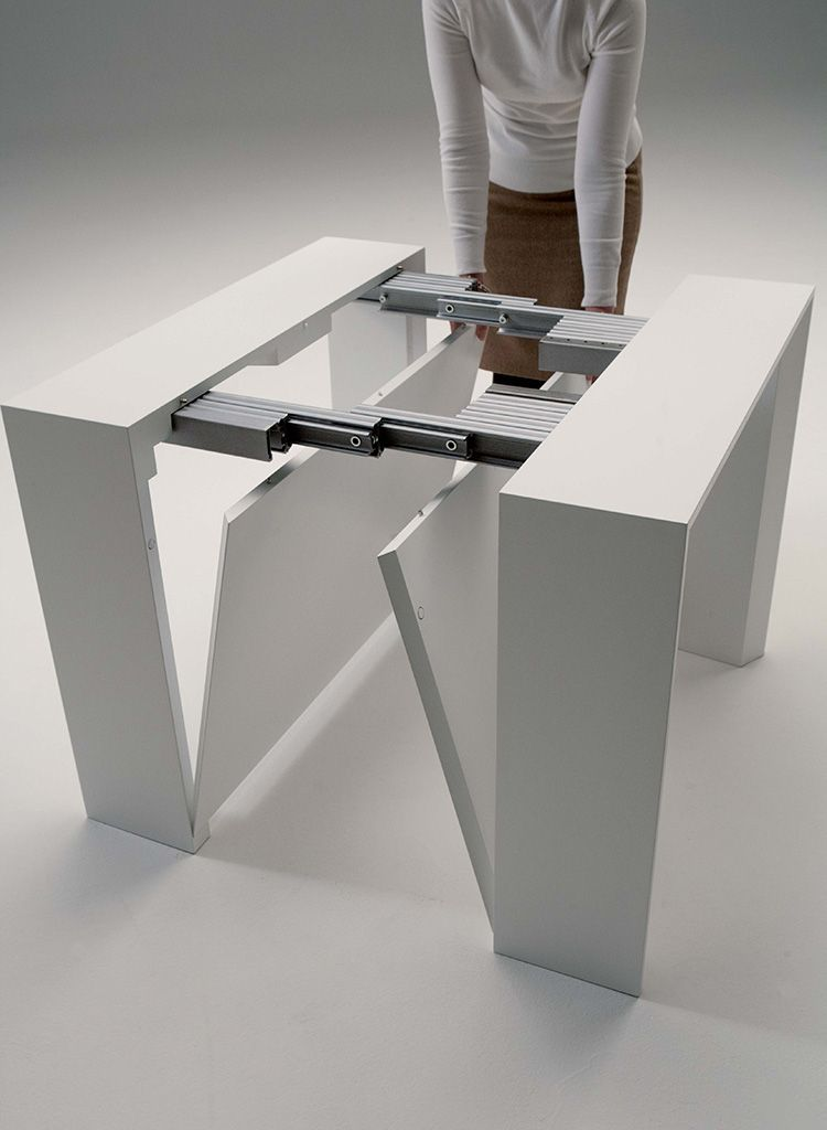the golietta is an expanding console to dining table with two self