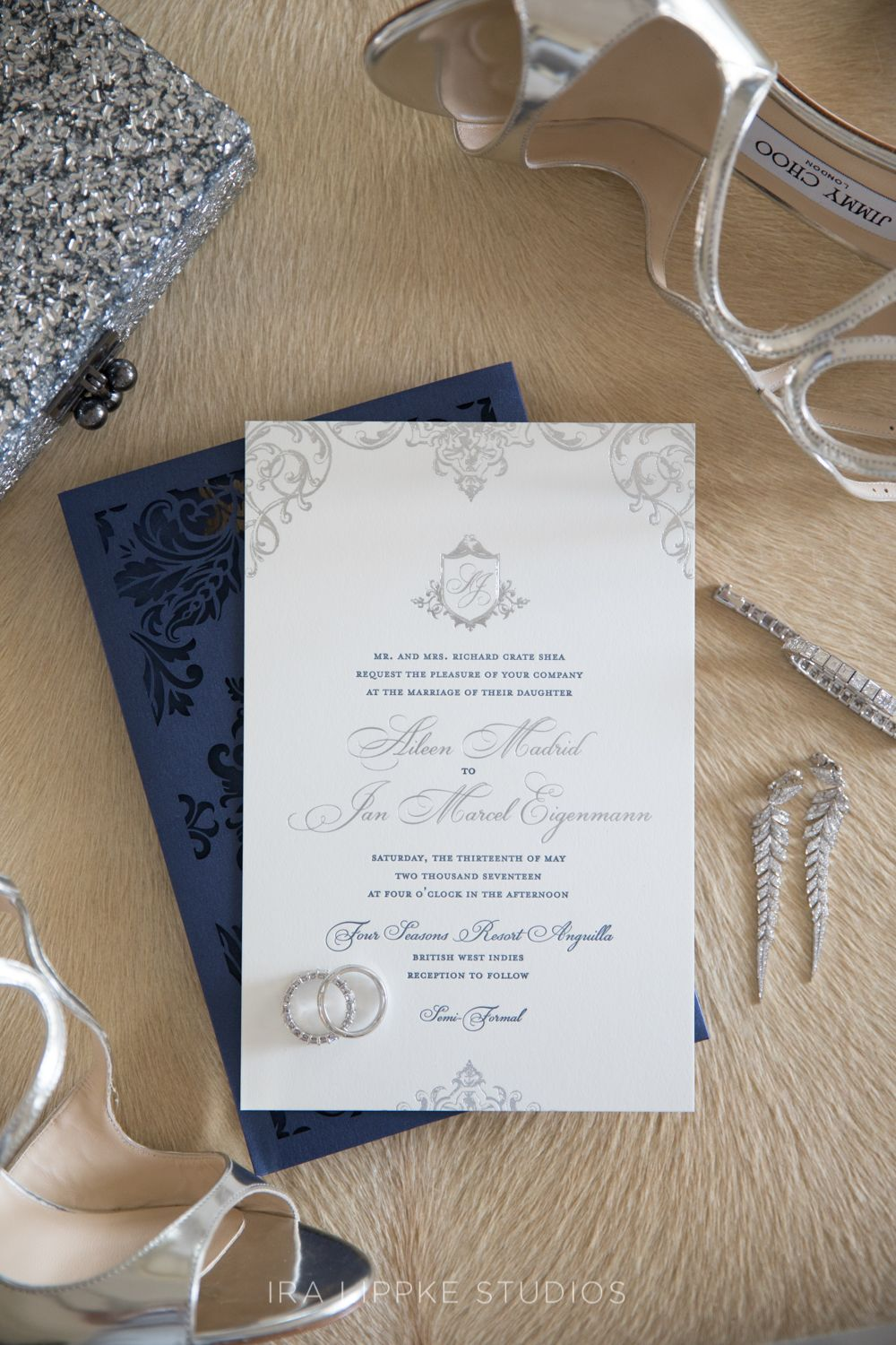 Navy blue and silver laser cut wedding invitation design for a ...