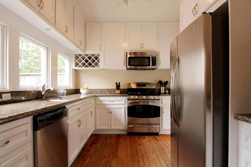 white kitchen cabinets with stainless steel appliances white cabinets and stainless steel appliances 29044