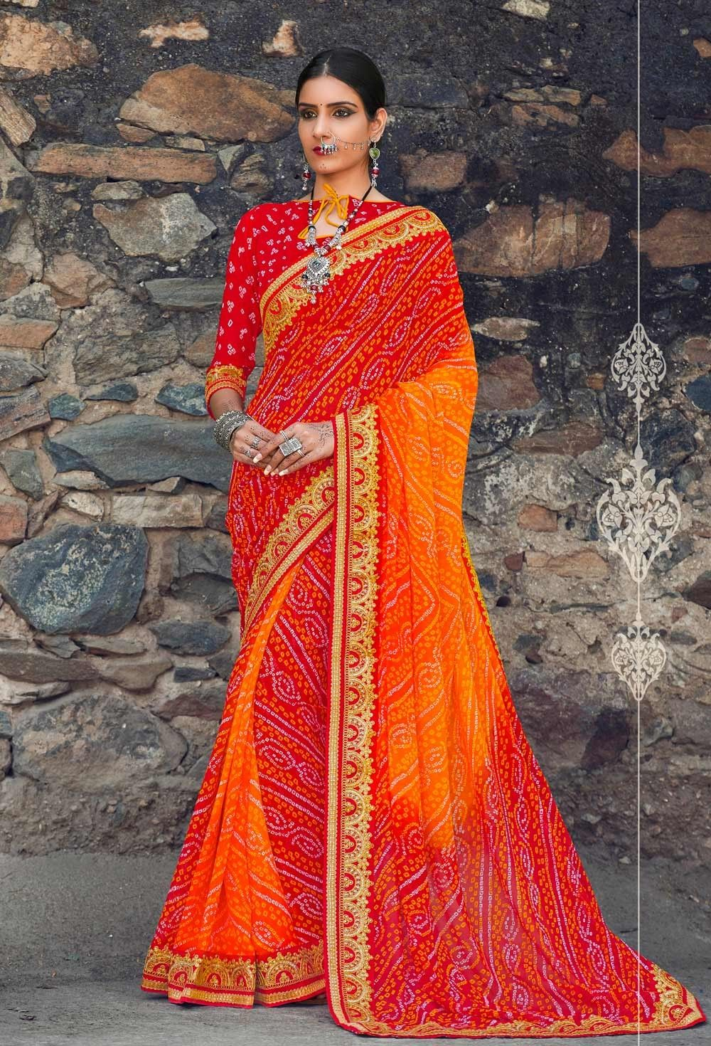 42c66c9c233ed Traditional Red and orange Gujarati Bandhani Saree With Golden Lace Border