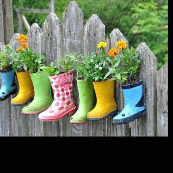 The Cottage Market: 25 Outdoor Ideas  love these pops of color from rain boots