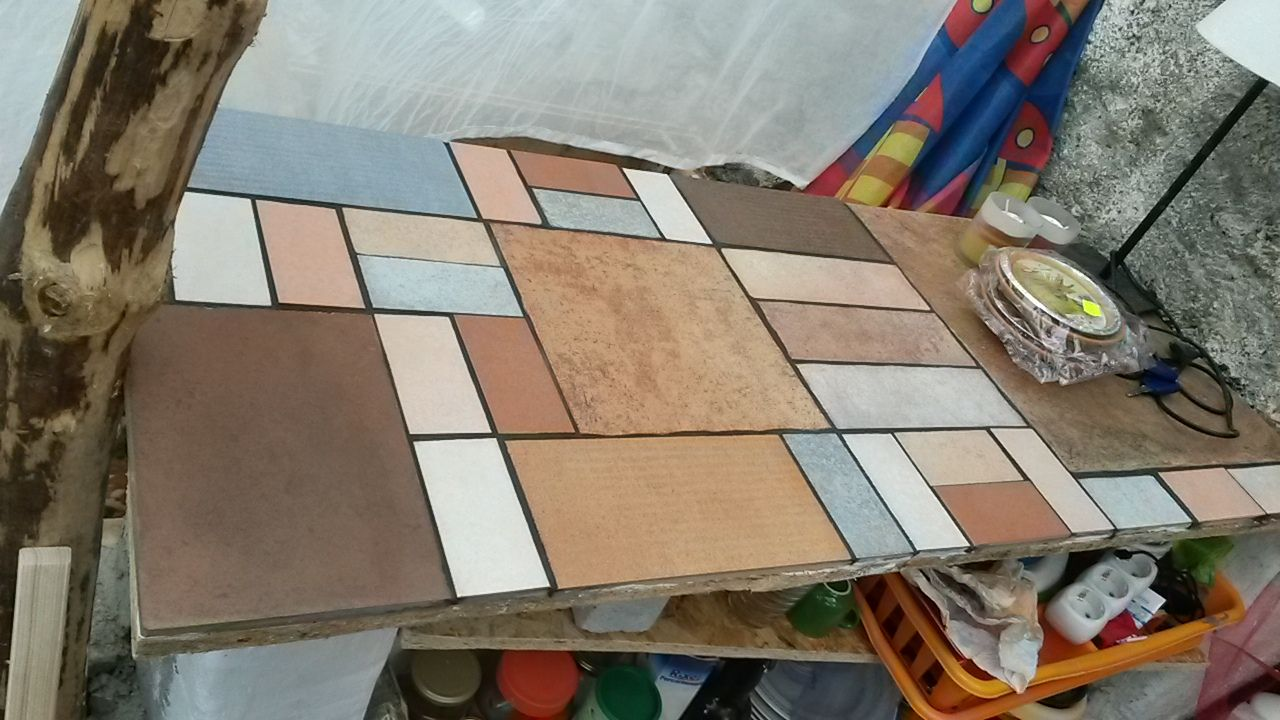 tile samples from a disused warehouse make for a great Mondrian-inspired kitchen worktop - Vasto, Italy