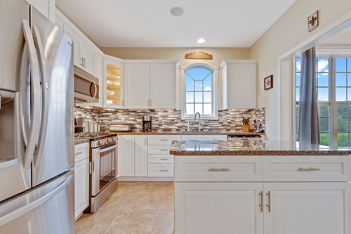 This Vibrant White Refaced Kitchen Was Renovated By Kitchen Saver In  Harrisburg, PA. These