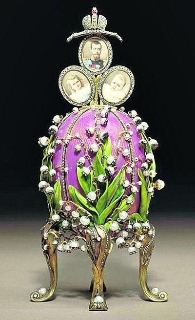 Faberge Lilies of the Valley Egg 1898. A gift from Nicholas II to his wife Alexandra. In gold, green gold, rose & green enamel, diamonds, rubies, pearls. Surprise is watercolor on ivory 3 portraits when turn pearl button on side. Now owned by Viktor Vekselberg at Faberge Museum St Petersburg