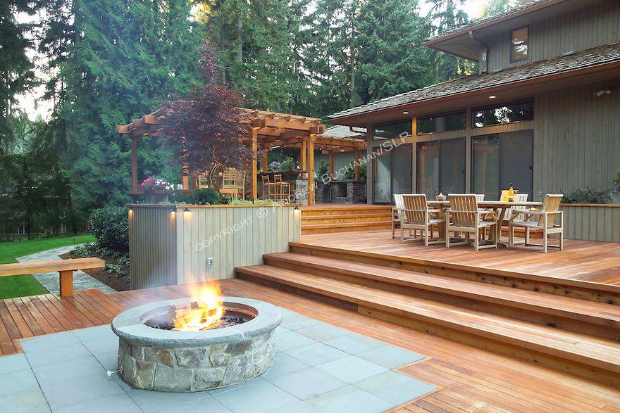 A Deck Made For Outdoor Entertaining Homeandgardenphotos Com Deck Fire Pit Fire Pit Plans Backyard Deck