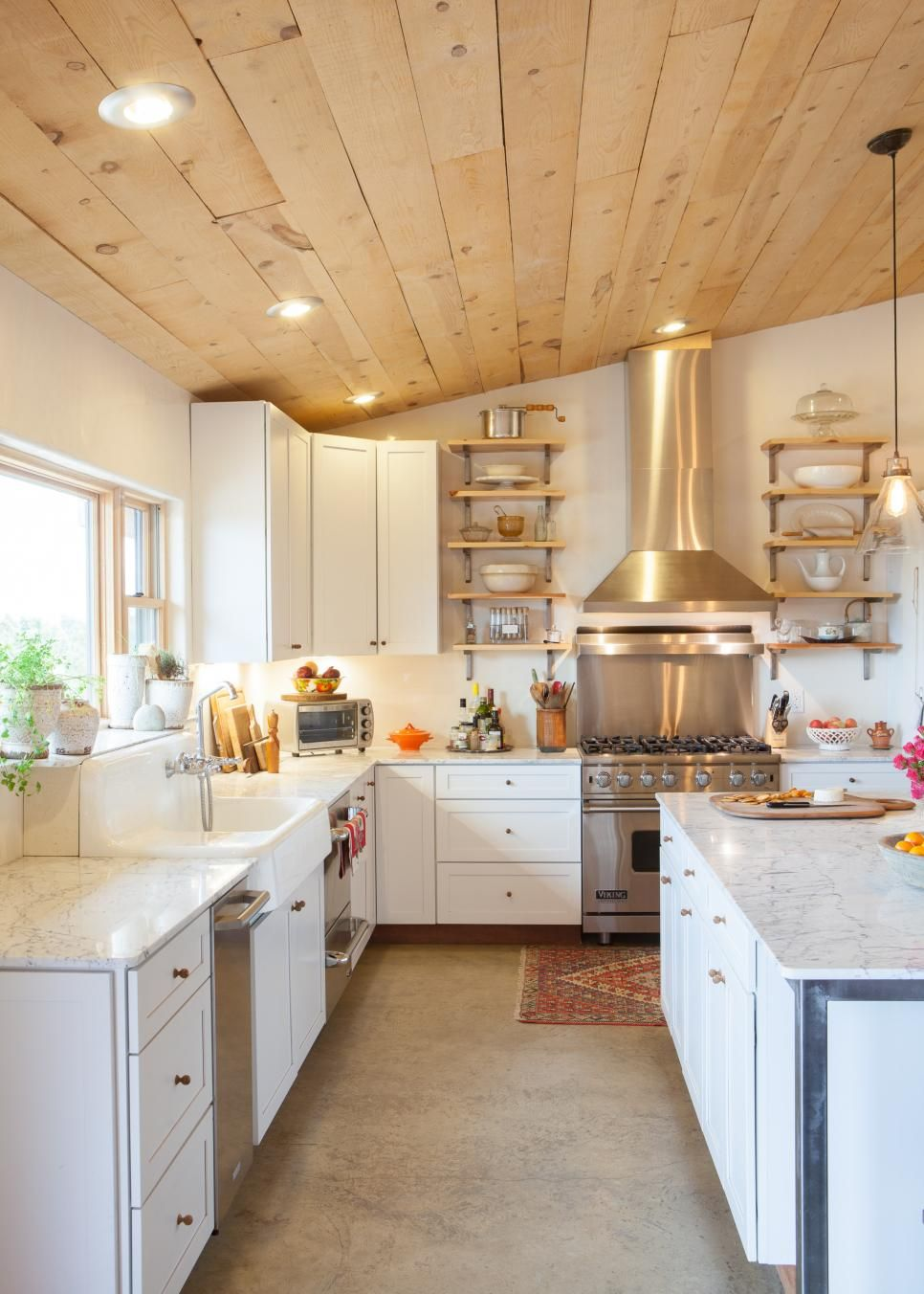 French Country Kitchen With Natural Wood Plank Ceiling Concrete Kitchen Floor Kitchen Flooring Wood Plank Ceiling