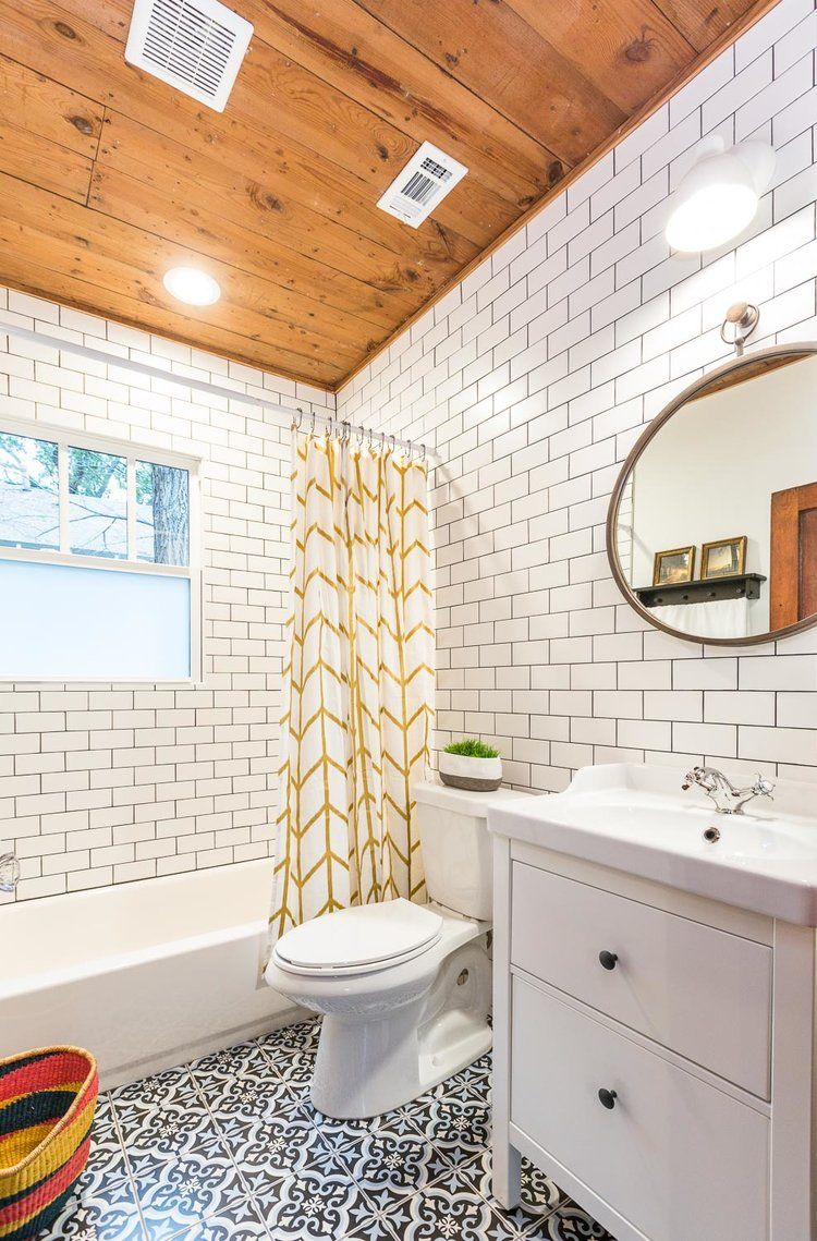 The hall bathroom has so much character using spanish tile keeping the cedar ceiling tiling the walls dailygadgetfo Choice Image