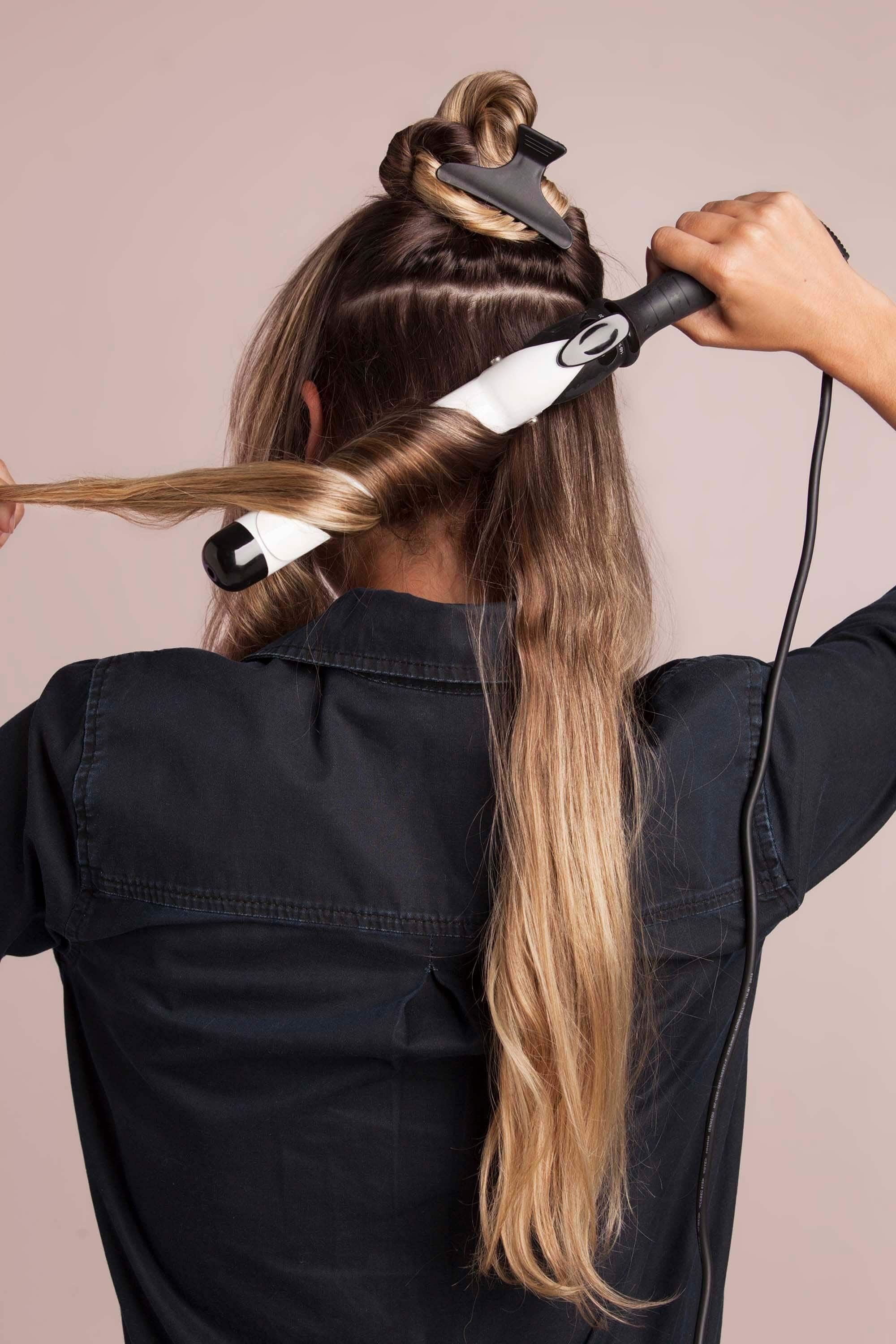 A stepbystep guide on how to use a curling iron on long