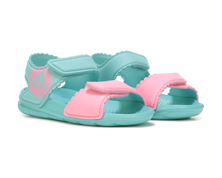 a94704e6111cc Shell love to go poolside in the AltaSwim Sandal from adidas.Mesh upper in  a casual outdoor sandal style with an open toeBandage texture detailDual  hook and ...