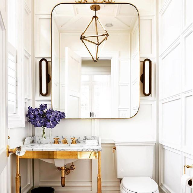 Beautiful bathroom in this design from @timothy_godbold. Love the gold and marble console sink! • • • • #bathroom #gold #mirror #interiordesign #interior #interiors #designs #instagood #instagram #instastyle #decor #architecture #homedecor #design #chandelier
