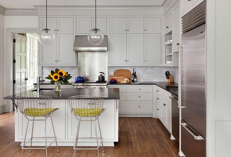 Best Stacked Off White Shaker Cabinets Flank A Stainless Steel 400 x 300