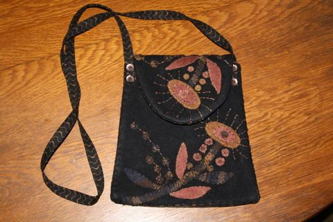 Wool wool applique based on a maggie bonanomi purse pattern