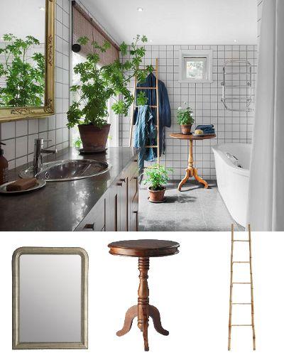 Une salle de bains banale transformée grâce à quelques petits meubles en bois (une échelle porte-serviettes par-ci, un miroir classique ou un vieux guéridon par-là) et à l'abondance de plantes vertes. #salledebains #planteverte