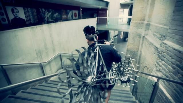 Video of Ron Arad's bike with steel-sprung tires! Works on the straight. Can't see it cornering well.