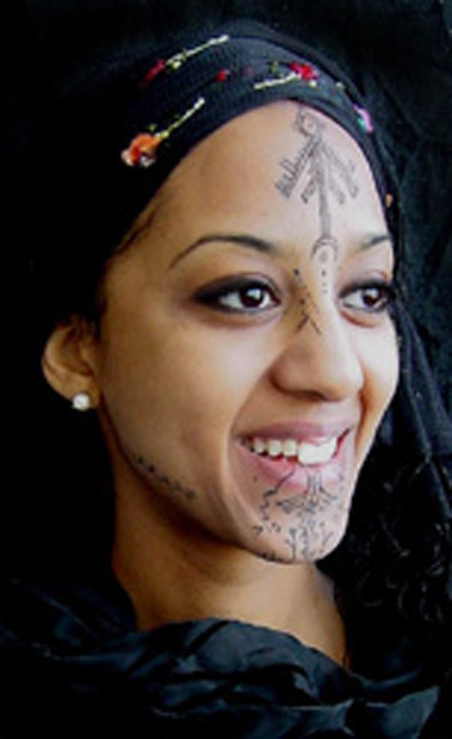 algerian women with a tribal tattoo.     musing over intriguing