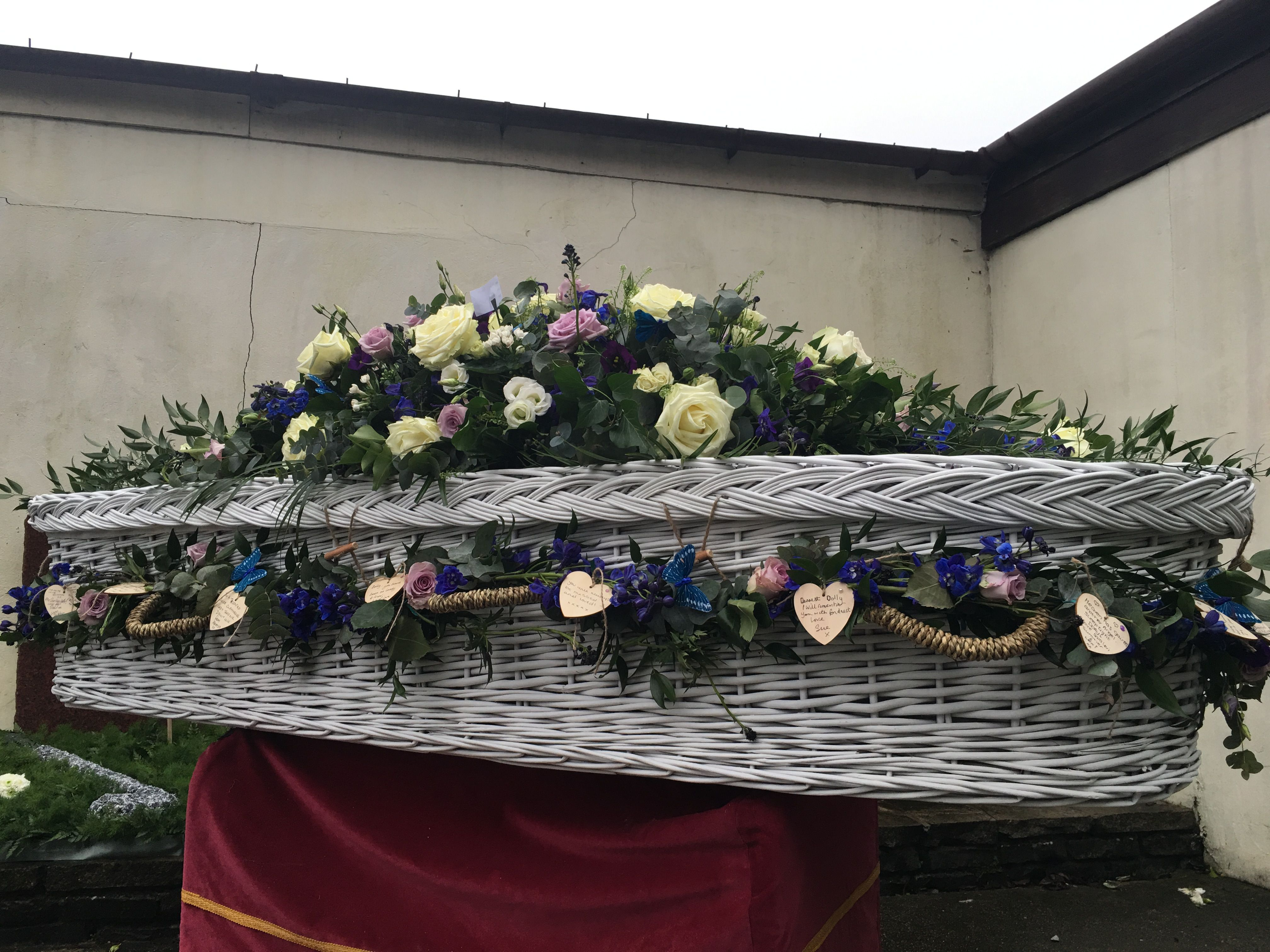 Funeral flowers wicker coffin garland funeral flower tributes funeral flowers wicker coffin garland dhlflorist Choice Image