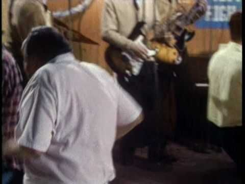 Weezer performing Buddy Holly. (C) 1994 Geffen Records