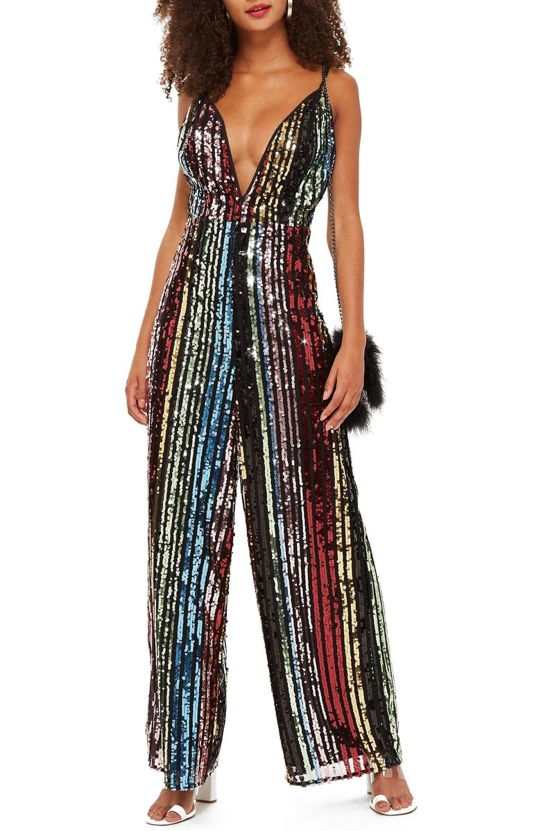 fbe367d604c8 Make connections aplenty in this rainbow-sequined jumpsuit with slinky  spaghetti straps crisscrossing in back and a plunging neckline in front.