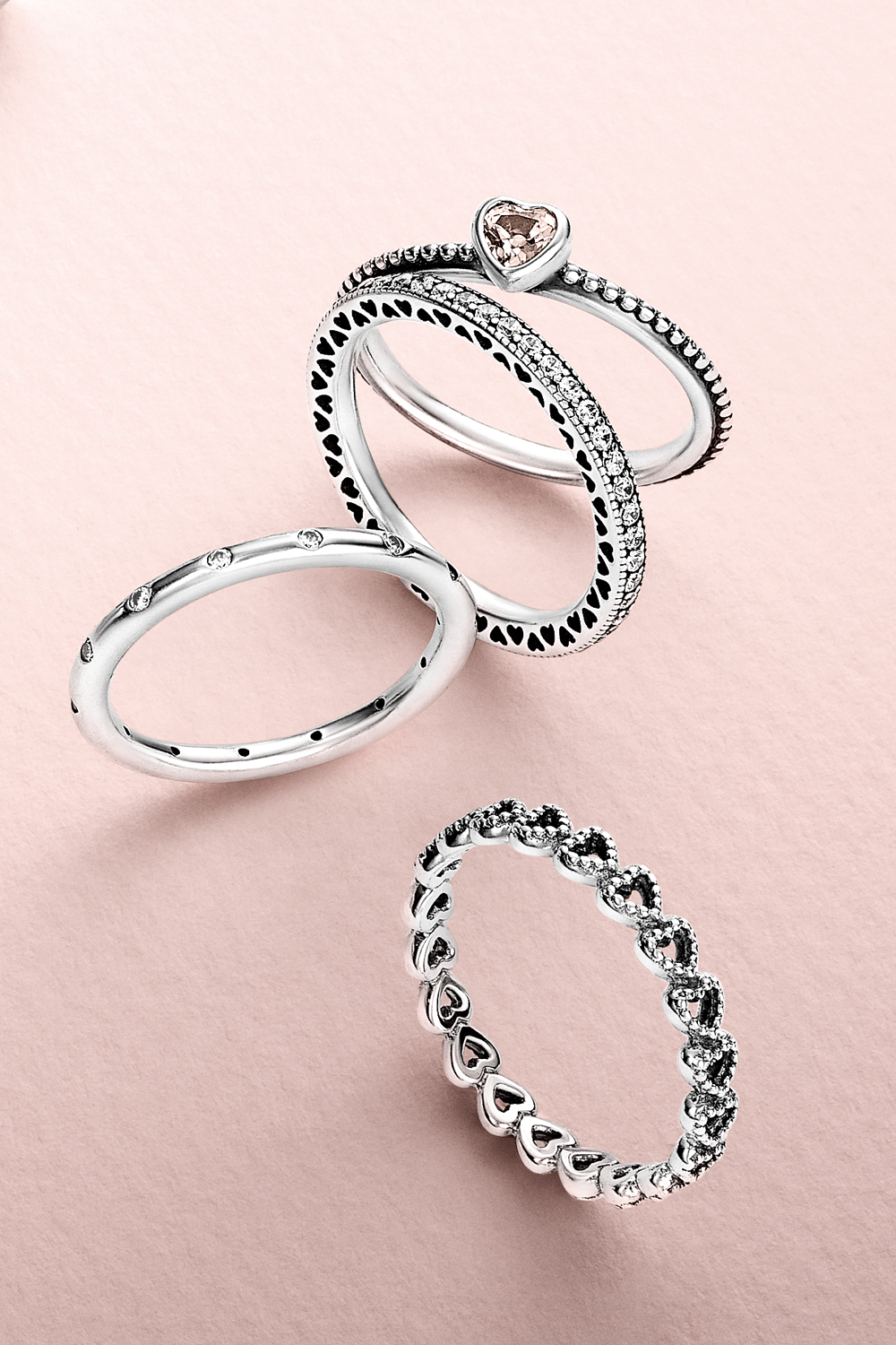 Create a romantic look by stacking cute heart-shaped rings ...