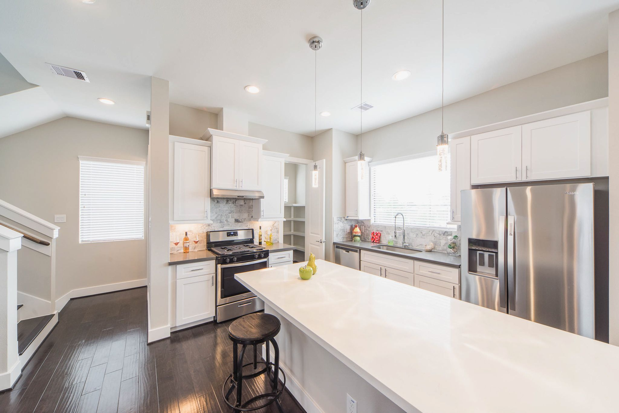 Gourmet Kitchen With White Cabinets And Stainless Steel Appliances White Kitchen Cabinets Kitchen Modern