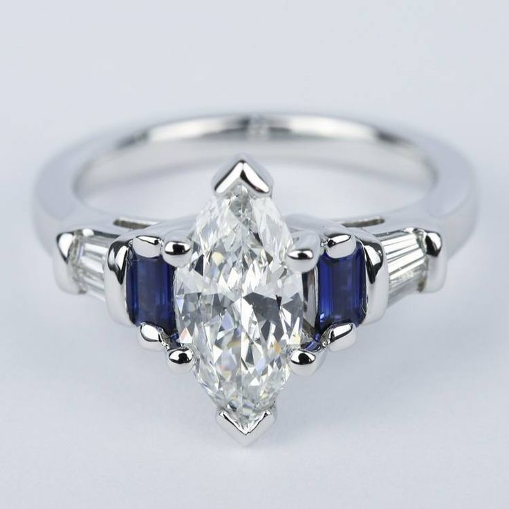 Four Side Stones Help To Balance The Height Of This Brilliant Mar Sapphire Engagement Ring Blue White Diamond Rings Engagement Marquise Diamond Engagement Ring