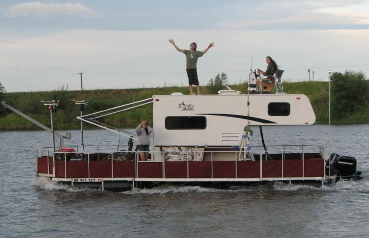 They Used A Floating Dock To Convert This Slide In Camper Into A Camper Barge Utility Boat Slide In Camper Camper Boat