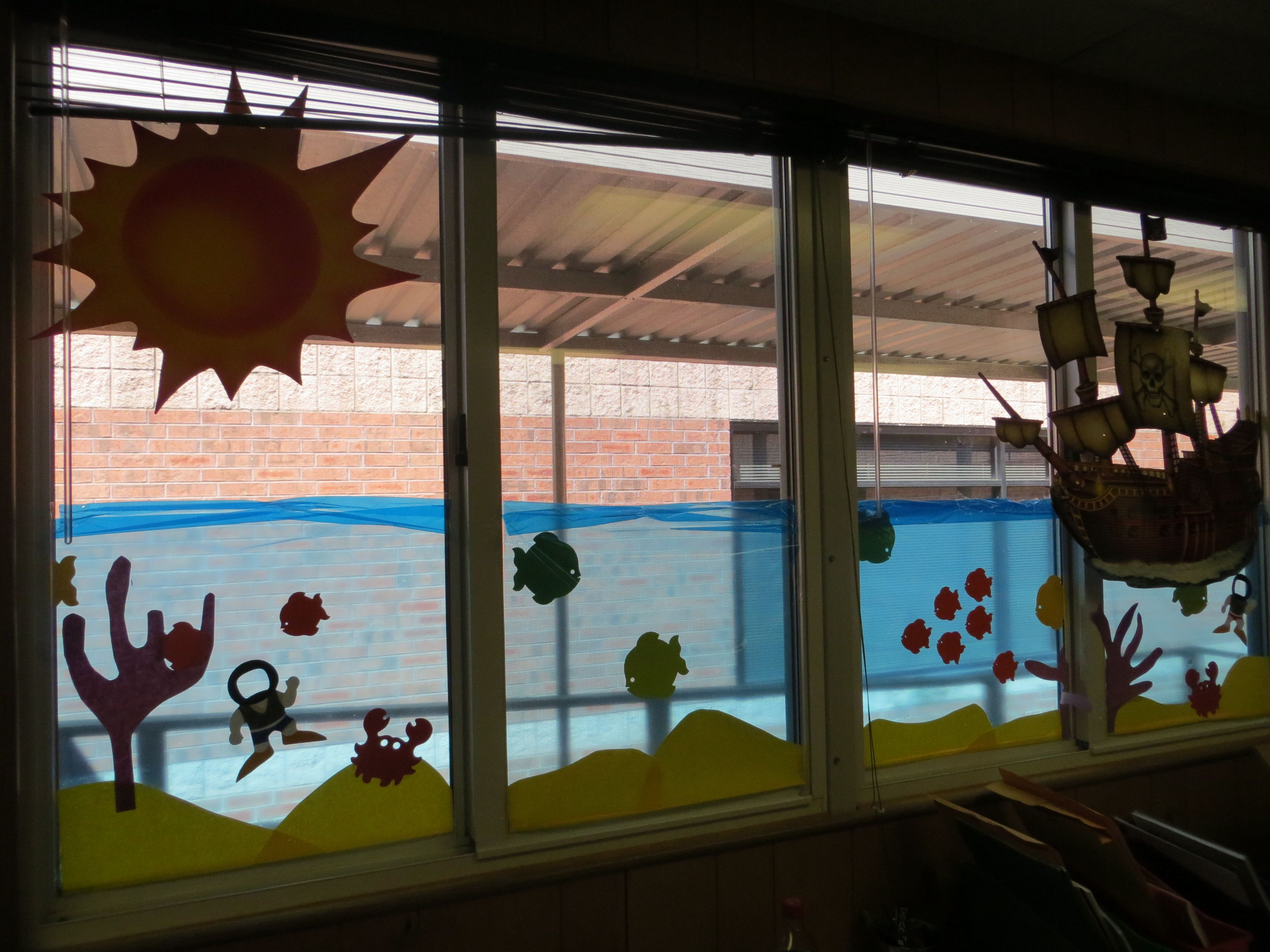 Classroom window decoration - Ocean Themed Classroom Window Blue Cellophane Butcher Paper Packing Tape Die