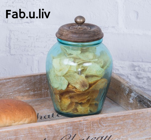 Soothing Aqua Toned Gl Is Topped With Wooden Lid And Br For A Fashionable Canister