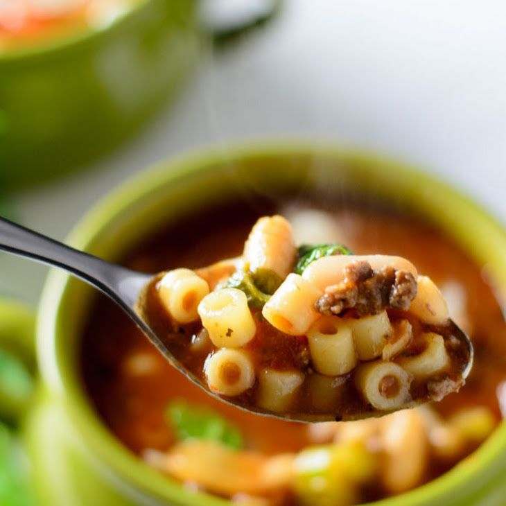 Pasta e Fagioli Recipe Soups, Main Dishes with ditalini pasta, chopped onion, carrots, chopped celery, ground chuck, salt, pepper, olive oil, garlic, tomato sauce, chicken broth, cannellini beans, oregano, thyme, fresh basil leaves, parmesan cheese