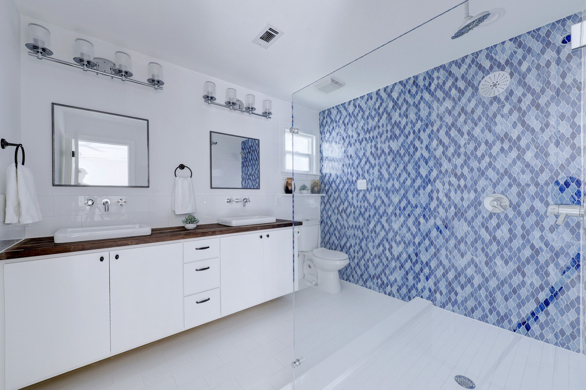 blue glass tile bathroom floor to ceiling, walnut butcherblock ...