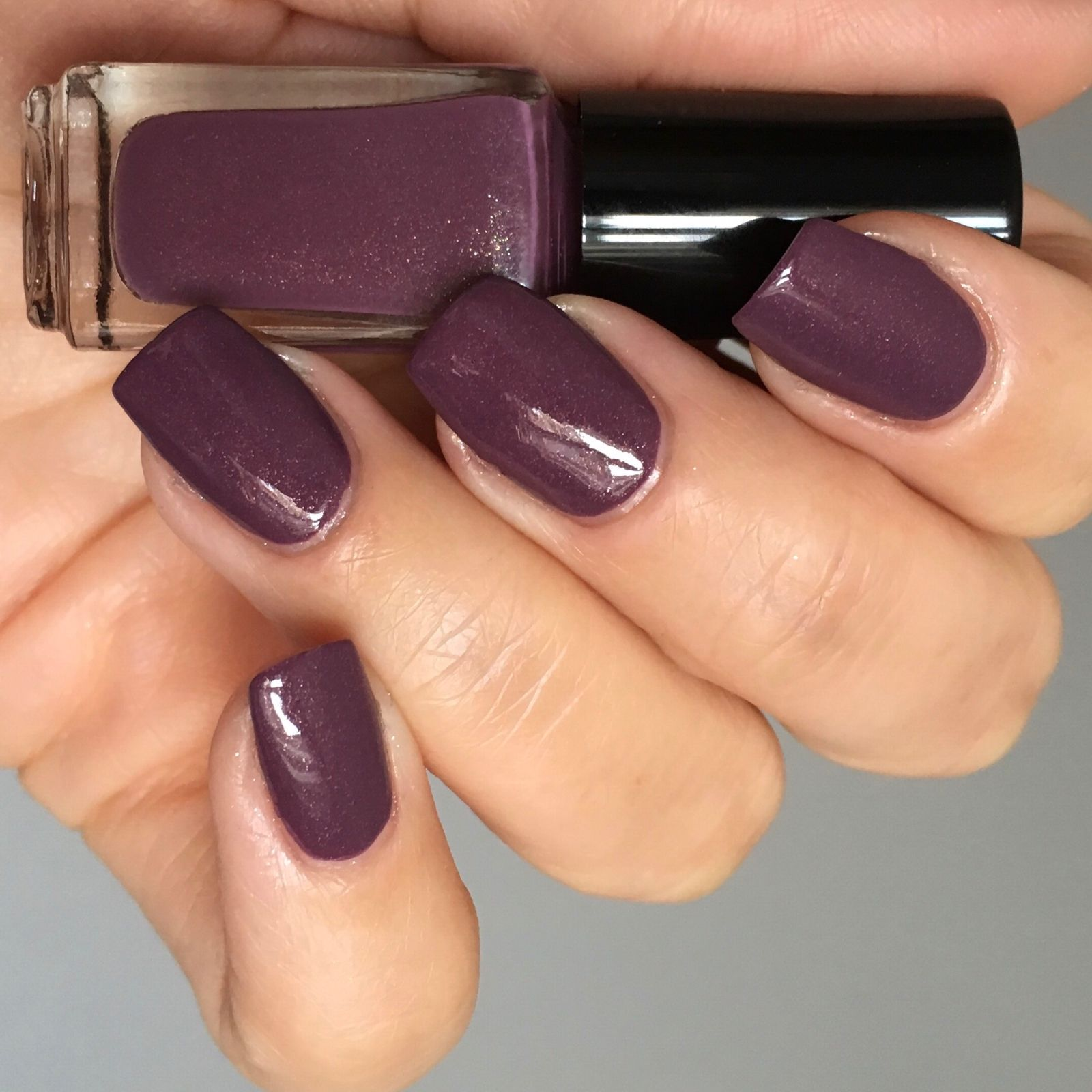 A gorgeous dark mysterious autumnal mauve polish with gold shimmer ...