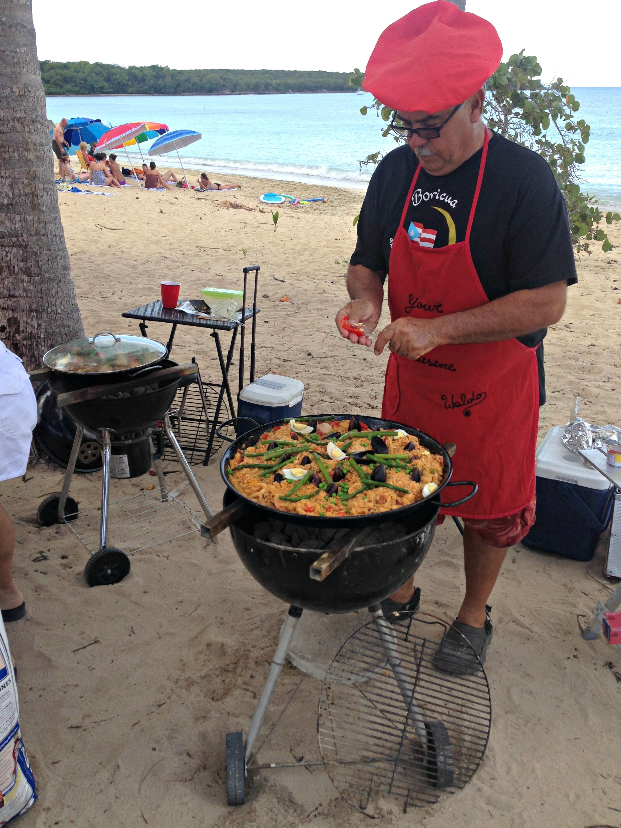 Paella over the fire is a delicious option to serve your guests at your beach party!