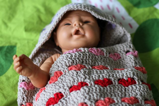 http://www.ravelry.com/patterns/library/cute-newborn-baby-hearts-cocoon