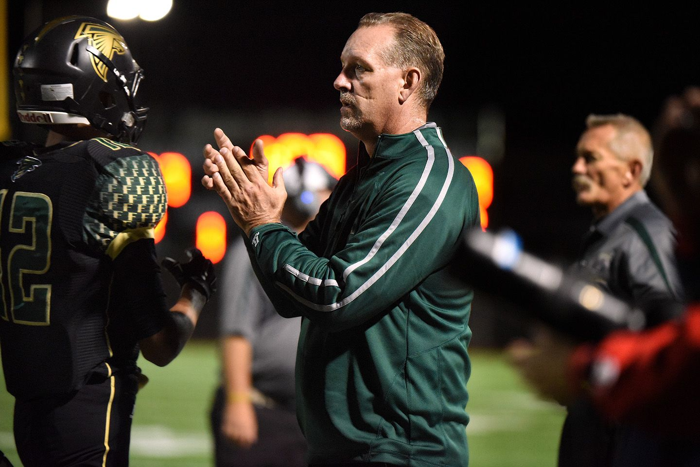 Falcons Head Coach Brian Green Applauds A Play Against The Scorpions Of Sand Creek High School During A Homecoming Footbal Sand Creek Homecoming Football Games