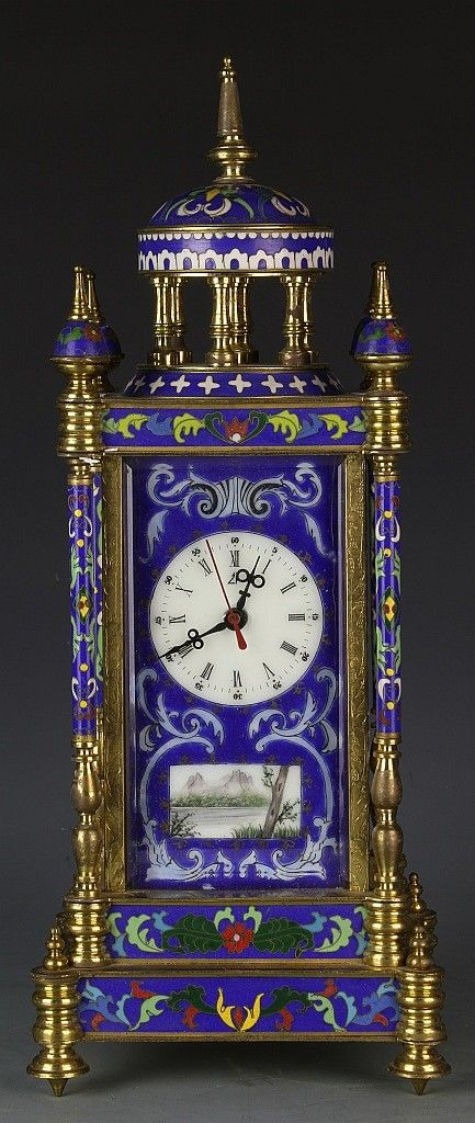 China, cloisonne clock, opulent design using gold pillar structure and temple like top, painted with floral motifs on a rich blue ground, featuring a picture of a lady on one side and small water landscape on the front. Height 15 in.