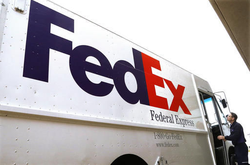 FedEx Express delivery vehicle and employee Paid time