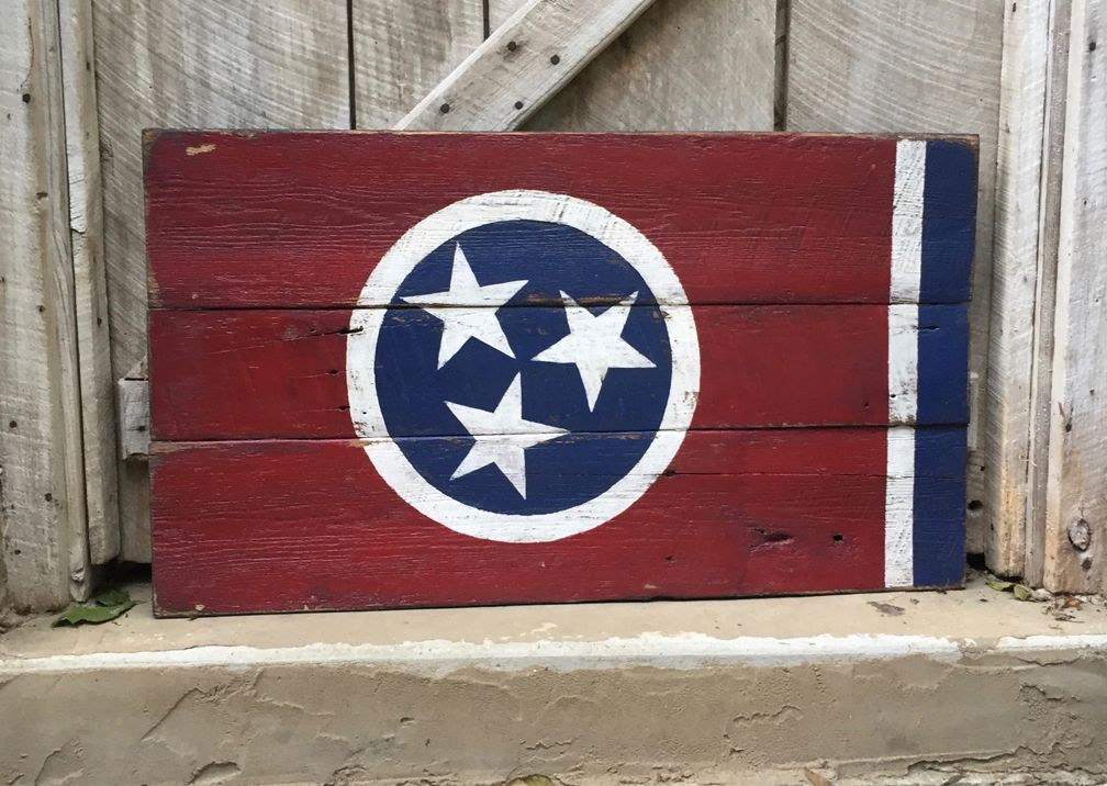"""Our Tennessee State flag is created on reclaimed barn wood from collected from a local Tennessee farm. We have hand painted and sealed to last with 2 metal hangers on back.  Approximate Size: 36"""""""" x 22""""  Order Online at www.signniche.com * Or local delivery to the Nashville, TN area, small delivery charges apply."""
