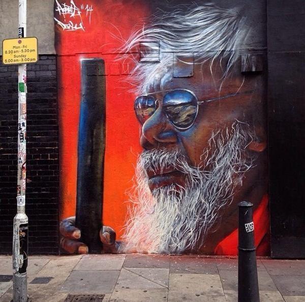 Aboriginal mural portrait Indigenous street painting australia adnate djalu gurruwiwi