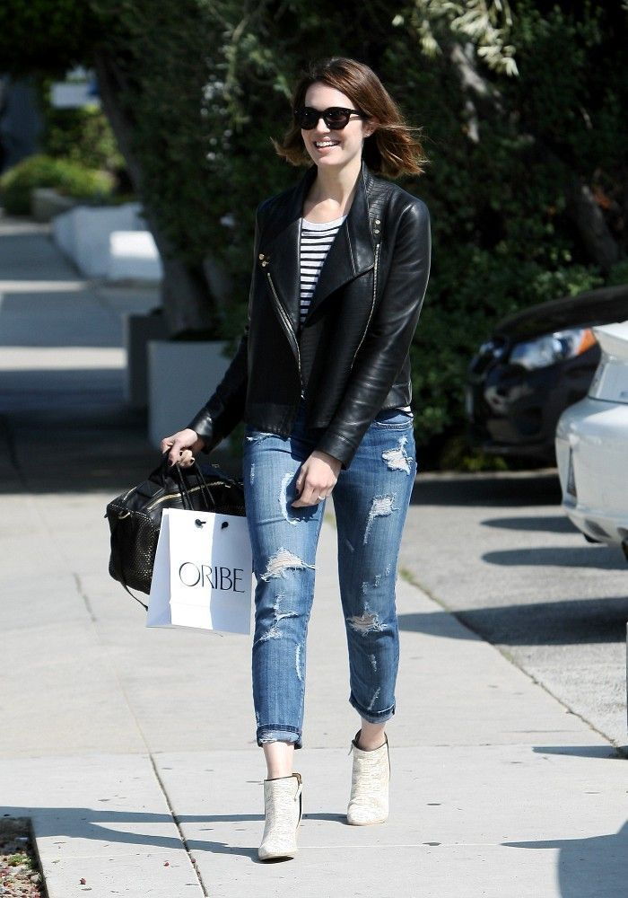 Mandy Moore takes the preppy-rocker route in torn jeans, stripes, and a rad moto jacket