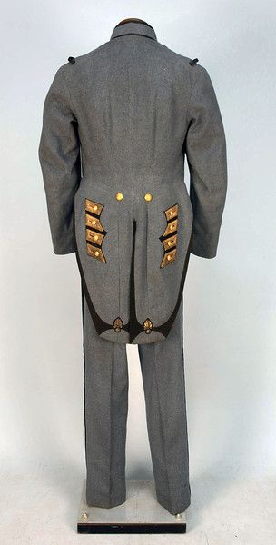NEW YORK NATIONAL GUARD UNIFORM,   1905.   C Company 7th Regiment, blue-grey wool felt with gilt brass buttons, black felt and metallic gold trim. Ch-38, inseam L-34. (Very minor moth damage). Provenance: Oswald W. Uhl, registered as marksman in 1899. Together with a Company C 7th Regiment hat.