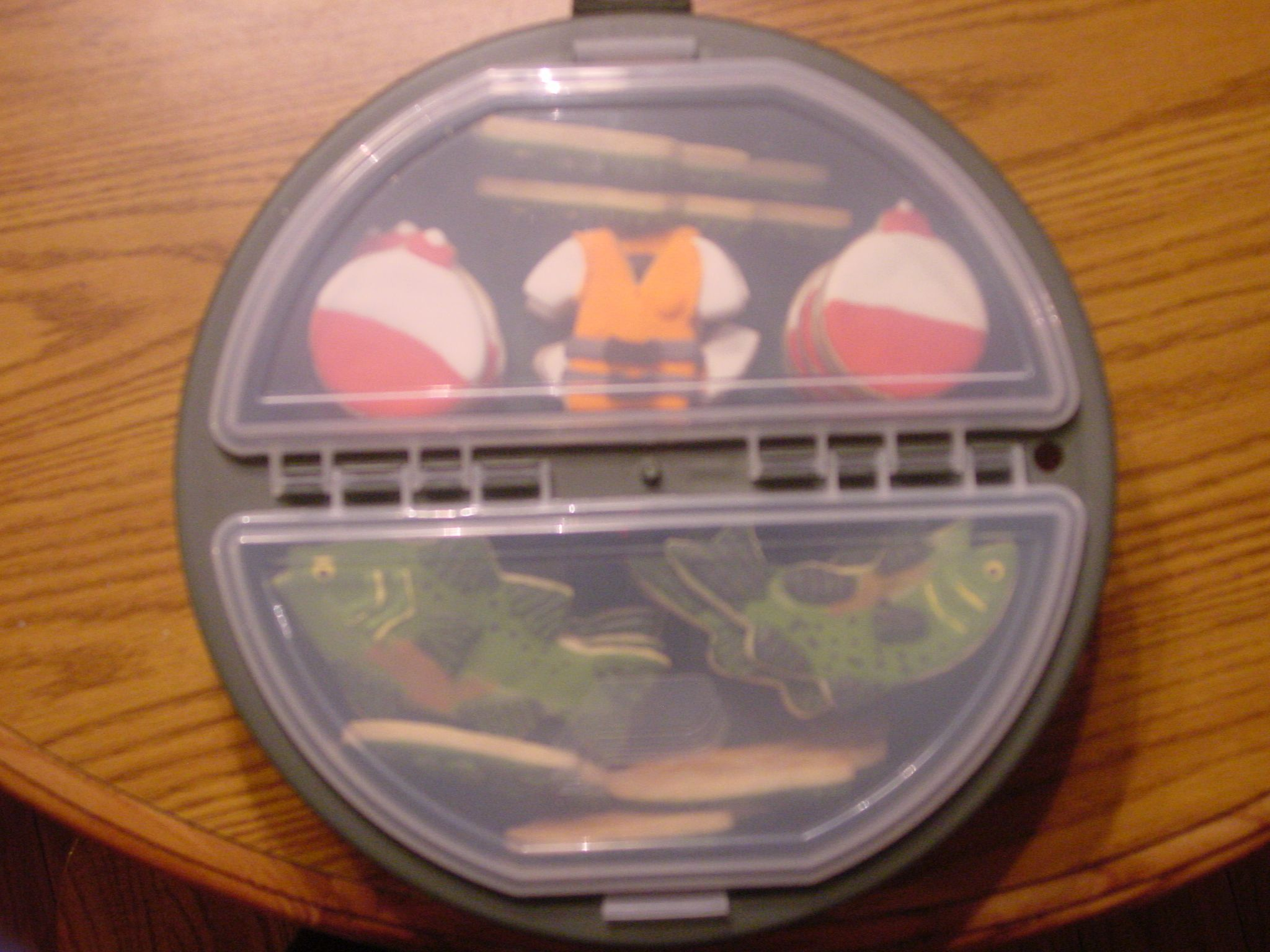 I used a tackle box for a fishing pail to put the fish cookies in as a gift.