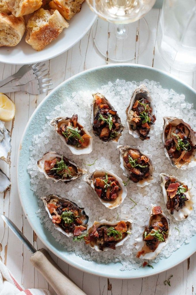 Skillet Baked Oysters with Shiitake Mushrooms, Bacon and Basil served with Torn Crostini