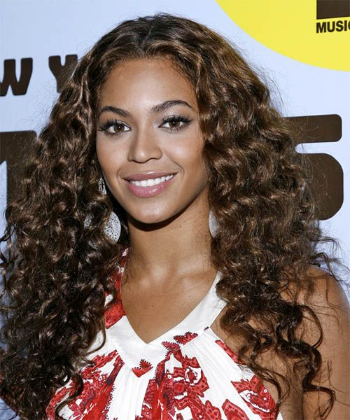 beyonce knowles long curly casual hairstyle - dark brunette