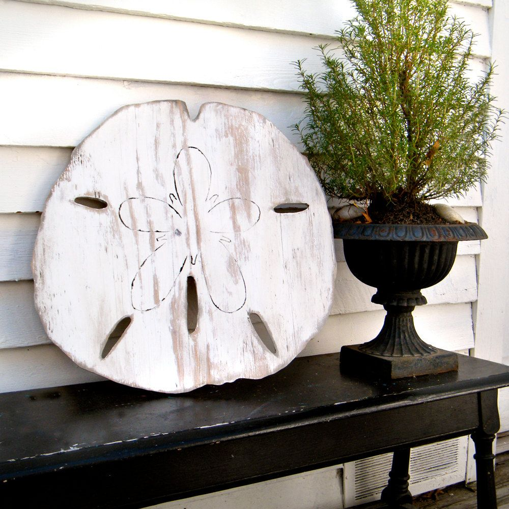 I really like this wooden oversized sand dollar beach decoration